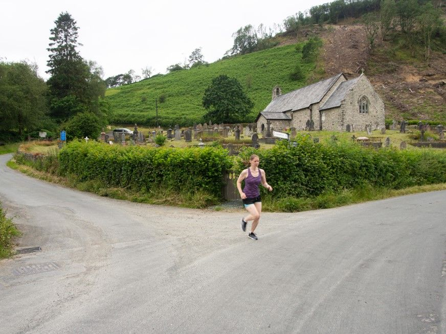 Runner passing St. David's